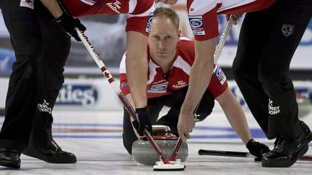 Canada skip Brad Jacobs, centre, watches his shot during the gold medal draw at the World Men's Curling Championship in Victoria, B.C. Sunday, April 7, 2013.
