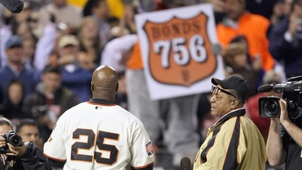 Barry Bonds of the San Francisco Giants celebrates with his godfather, Willie Mays, after hitting his record-breaking 756th career home run on August 7, 2007 at AT&T Park in San Francisco.