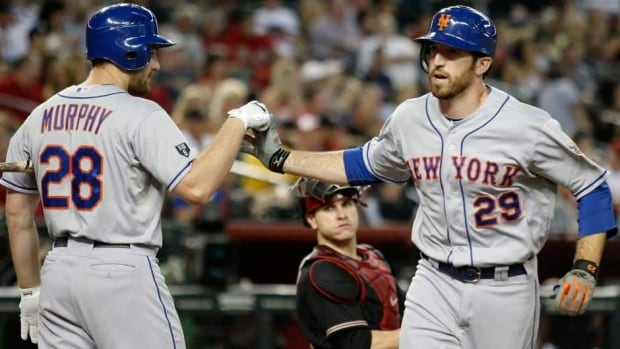 Ike Davis, right, celebrates with New York Mets teammate Daniel Murphy after hitting a solo home run against the Arizona Diamondbacks in the second inning on Saturday.