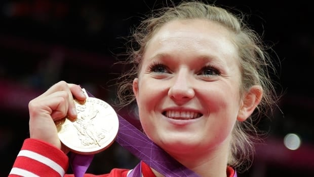 Canada's Rosannagh MacLennan displays her gold medal during the podium ceremony of the women's trampoline on Saturday in London.