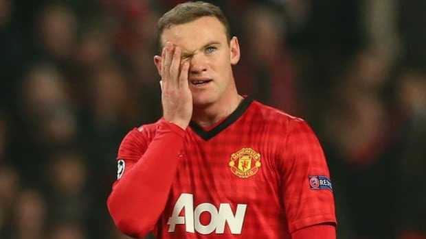 Wayne Rooney reacts to a missed opportunity in United's 2-1 loss to Real Madrid on Tuesday.