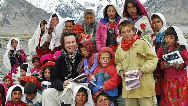 Greg Mortenson poses with Sitara Star schoolchildren in Wakhan, northeastern Afghanistan. Mortenson is the author of the best-selling book, Three Cups of Tea: One Man's Mission To Promote Peace ... One School At A Time, about his mission to raise funds for schools in Pakistan and Afghanistan.