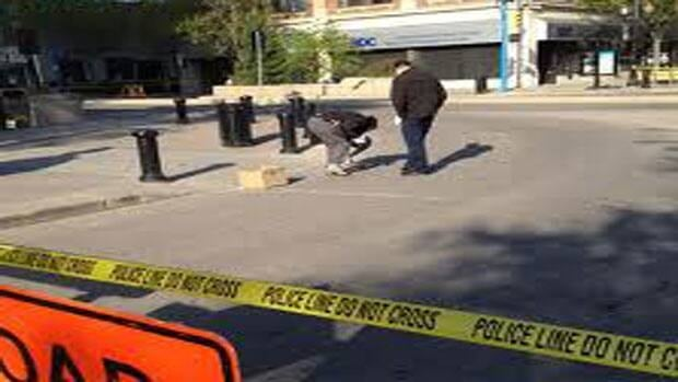 Investigators gather evidence after a fatal nightclub shooting in Saskatoon last year.