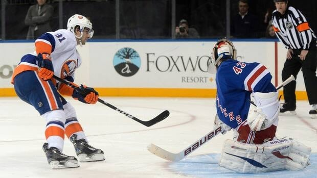 John Tavares, left, beat Rangers goalie Martin Biron on a shootout attempt to help the Islanders to a win on Valentine's Day.