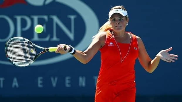 Aleksandra Wozniak returns a shot against Lucie Safarova during their women's singles match at the 2012 U.S. Open on August 29, 2012.