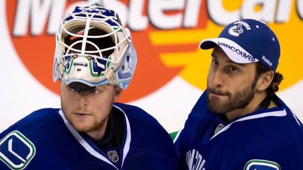 Vancouver Canucks' goalie Roberto Luongo, right, told a Vancouver radio station that 'it's time to move on' during an interview on Friday.