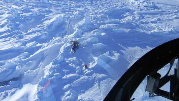 A photograph taken from a search and rescue helicopter shows the snowmobile abandoned by the boy who died in Labrador.