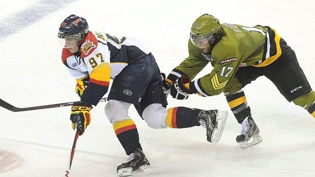 Connor McDavid of the Erie Otters tries to get past Nicholas Foglia of the Brampton Battalion during the first period of an Ontario Hockey League game at Erie Insurance Arena, in Erie, Pa., on Oct. 5, 2012.