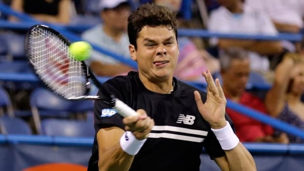 Milos Raonic hits the ball during his match with Samuel Groth at the Citi Open tennis tournament Tuesday in Washington.