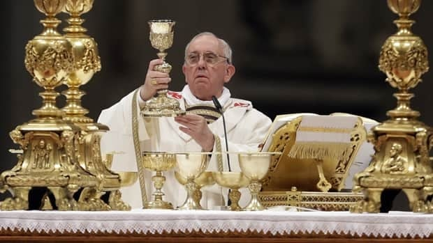Pope Francis leads the Easter vigil service in St. Peter's Basilica at the Vatican.