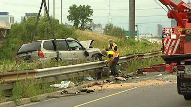 Police say a GMC Envoy was going the wrong way when it collided Sunday morning with a Dodge Caravan on a ramp connecting the eastbound QEW to Highway 427.