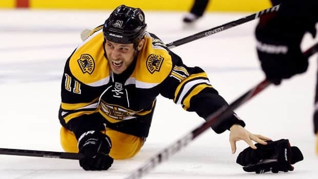 Boston Bruins forward Gregory Campbell attempts to get up and back into the play after suffering his playoff-ending injury in Game 3 of the Eastern Conference final against the Pittsburgh Penguins.