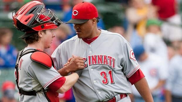 Cincinnati Reds pitcher Alfredo Simon, right, shakes hands with catcher Ryan Hanigan after beating the Chicago Cubs 5-3 on Thursday.
