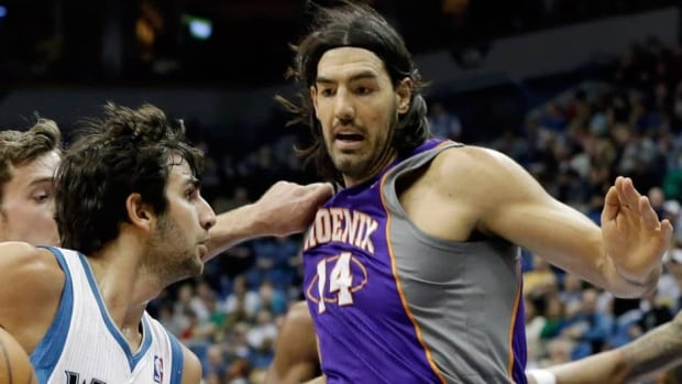 Luis Scola averaged 12.8 points and 6.6 rebounds over 82 games with Phoenix last season.