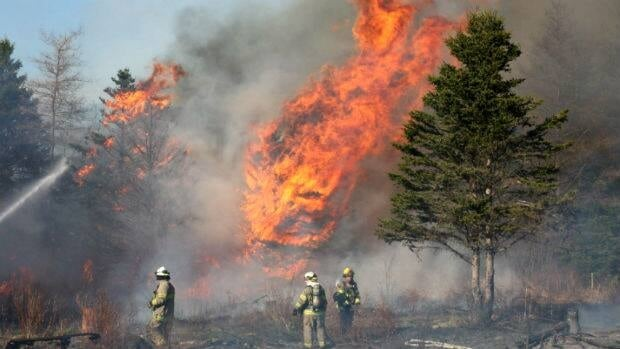 Firefighters tackle a fire Sunday in the Goulds area of St. John's.