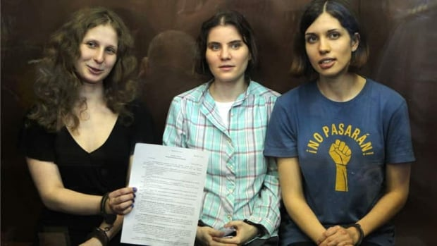 Feminist punk group Pussy Riot members, from left, Maria Alekhina, Yekaterina Samutsevich, and Nadezhda Tolokonnikova show the court's verdict in Moscow on Friday.