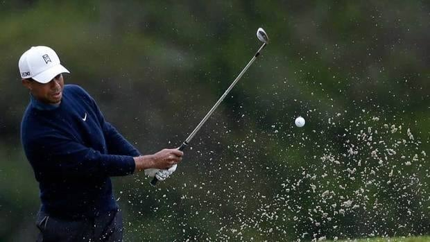 Tiger Woods hits out of a bunker on the sixth hole of the north course at Torrey Pines during the second round of the Farmers Insurance Open on Friday in San Diego.