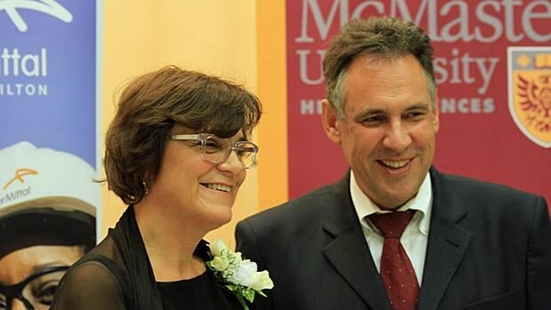 Dr. Paola Muti, shown with ArcelorMittal Dofasco CEO Juergen Schachler, is McMaster University's new cancer research chair. (Flannery Dean/CBC)