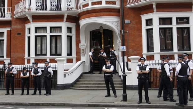 British police officers stand guard outside the Ecuadorian Embassy in central London after Ecuadorean Foreign Minister Ricardo Patino announced that he had granted political asylum to WikiLeaks founder Julian Assange.