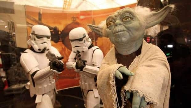 Models of Star Wars stormtroopers and the character Yoda are shown at the  O2 Arena in London. Disney confirmed Tuesday that it would create spinoff movies based on Star Wars characters.