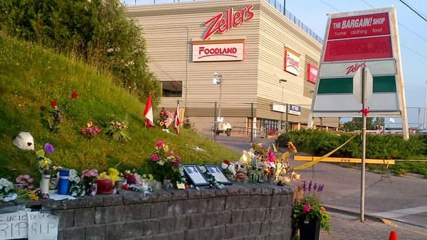 A shrine sits outside the Algo Centre Mall in Elliot Lake to commemorate the two women who died in the mall's roof collapse June 23. An OPP criminal investigation into the matter is now underway.