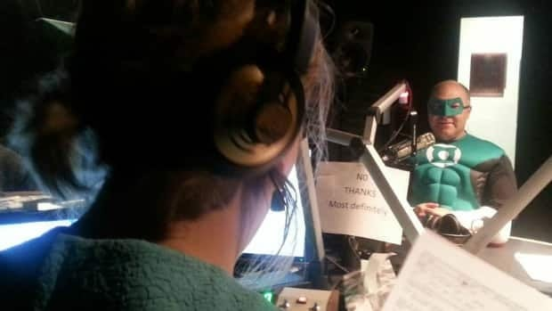 Pat Thompson, owner of 8th Street Books & Comics, joins host of Saskatoon Morning Leisha Grebinski in studio on Thursday dressed as the Green Lantern.