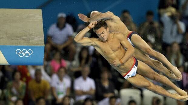 "British diver Tom Daley, front, was on the receiving end of some offensive tweets after he and fellow diver Pete Waterfield finished out of the medals in the 10-metre men's synchronized platform final. Now, police have arrrested a 17-year-old on ""suspicion of malicious communications."""