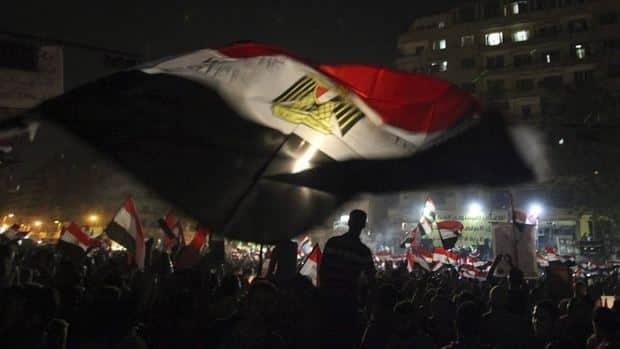 Egyptians celebrate the victory of Mohammed Morsi in Tahrir Square, Cairo on Monday.