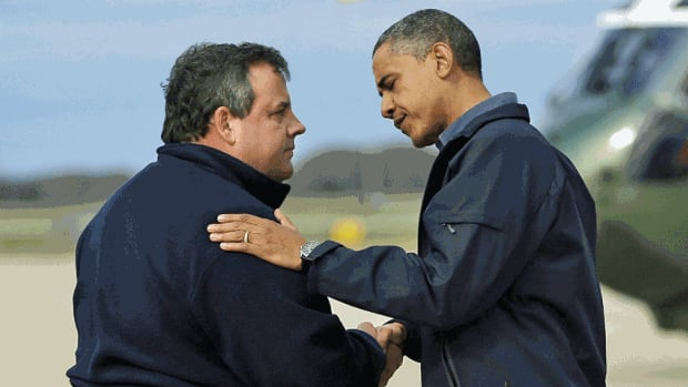 President Barack Obama is greeted by New Jersey Gov. Chris Christie upon his arrival at Atlantic City International Airport on Wednesday in Atlantic City, NJ. Obama travelled to region to take an aerial tour of the Atlantic Coast in New Jersey in areas damaged by superstorm Sandy,  (AP Photo/Pablo Martinez Monsivais)
