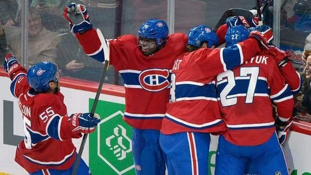 Montreal Canadiens' P.K. Subban (76), Francis Bouillon (55), Brandon Prust (8), and Alex Galchenyuk (27) celebrate a goal by teammate Brendan Gallagher (not shown) against the Buffalo Sabres on Saturday.