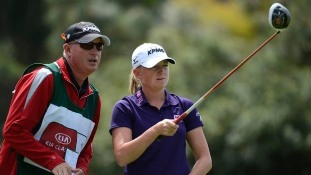 Stacy Lewis lines up drive with caddie during the opening round of the Kia Classic at the Park Hyatt Aviara Resort on Thursday in Carlsbad, Calif.