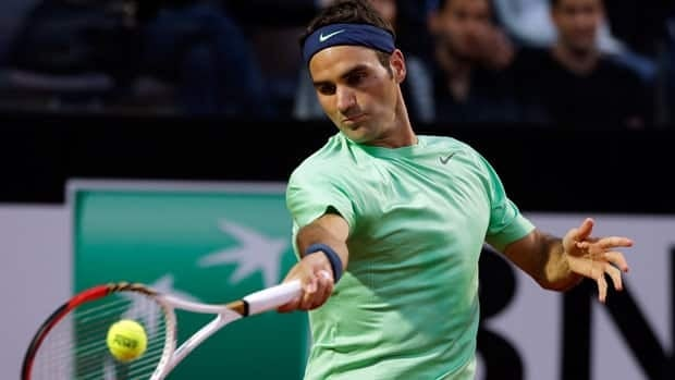 Switzerland's Roger Federer returns the ball to Italy's Potito Starace during their match Tuesday in Rome.