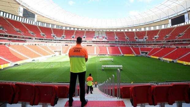 A staff steward looks out on Brasilia Stadium, where the Confederations Cup begins June 15.