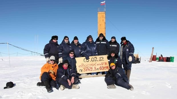 Russian researchers at the Vostok station in Antarctica pose for a picture after reaching subglacial lake Vostok.