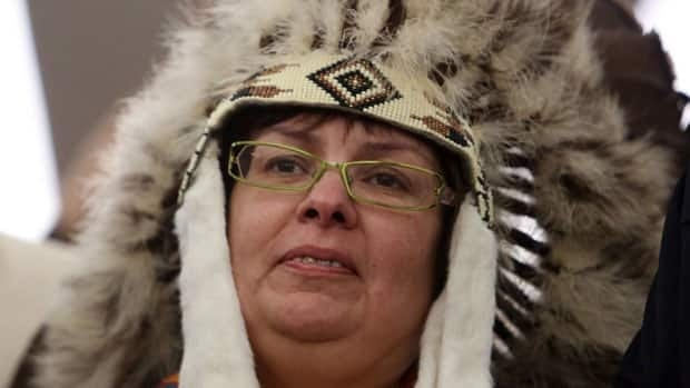 Attawapiskat Chief Theresa Spence, wearing a headdress, announced on Jan. 11 that she will continue her month-long hunger strike, in the hopes of getting a meeting with both Prime Minister Stephen Harper and Gov. Gen. David Johnston.