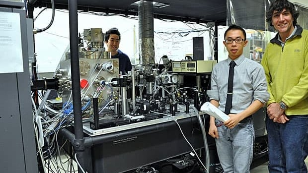 University of Toronto (Left to right) Ph.D. candidate Meng (Raymond) Gao, PhD candidate Lai Chung (Nelson) Liu (black tie), and research associate Gustavo Moriena pose with the equipment used to create the molecular movie. They were among the co-authors of the study published this week in Nature.