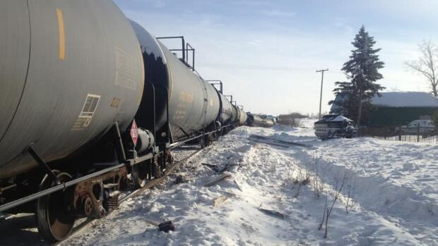 A crash involving a CN train and snow grader left one man dead and caused an oil spill.