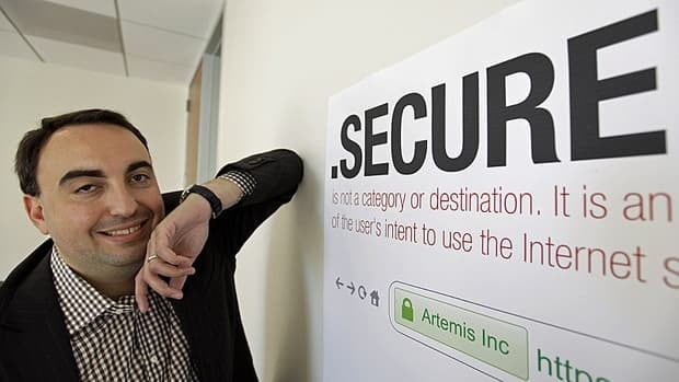 Alex Stamos, the chief technology of Artemis Internet, an NCC Group Company, poses by a domain name poster at their offices in San Francisco.