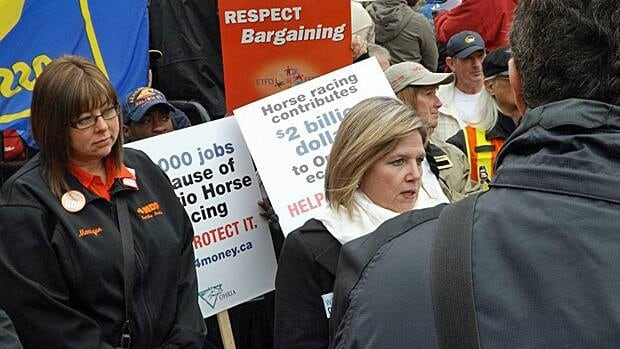 Hamilton Mountain MPP Monique Taylor, left, shown at a recent rally with NDP leader Andrea Horwath, introduced a bill that would give Ontario's Ombudsman the ability to investigate decisions made by children's aid societies. With Premier Dalton McGuinty proroguing the legislature, that bill has now died. (moniquetaylormpp.ca)