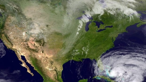 This satellite image taken Thursday, and provided by the National Hurricane Center, shows Hurricane Sandy moving northward across eastern Cuba.