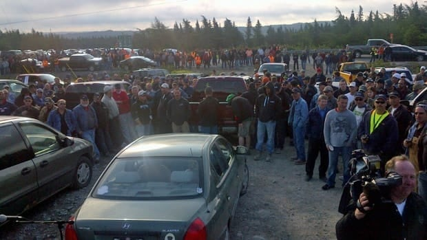 A large crowd has gathered near the road to Long Harbour and the Vale construction site.
