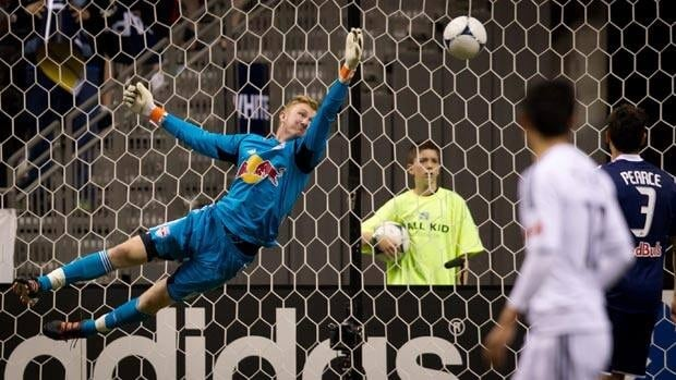 New York Red Bull' goalkeeper Ryan Meara allows a goal off the foot of Vancouver's Martin Bonjour during MLS action Wednesday.