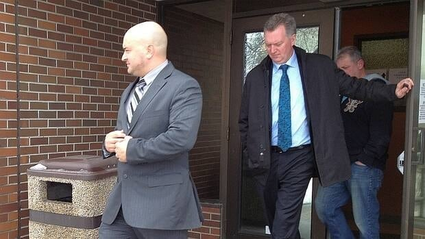 OPP officer Brian Bellefeuille (left) leaves a Thunder Bay courtroom with his lawyer, Andrew McKay.