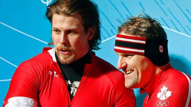 Canada's Jesse Lumsden, left, seen here celebrating victory in the two-man bobsled competitin with Pierre Lueders, says there are elements of football that smooth the transition from gridiron to sled.
