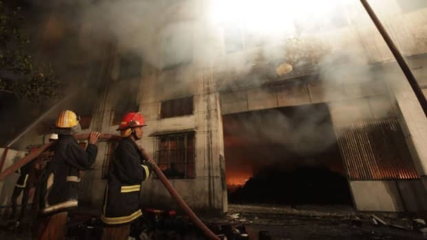 Firefighters try to control a fire in a garment factory in Savar, on the outskirts of Dhaka November 24, 2012.