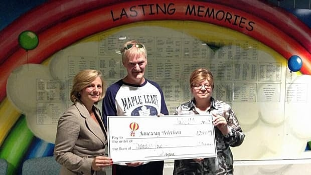 Al Rogers (centre) gives a cheque for $2,500 in his father's name to Karen Stevens (left) and Ruth Squires (right) of the Janeway Children's Hospital Foundation.