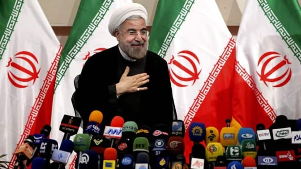 Hasan Rowhani tells a press conference in Tehran, Iran on June 17, that after his surprising first-round election victory, his government will include 'moderates, principlists [hardline conservatives] and reformists.