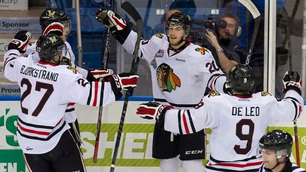 From left, Winterhawks' Oliver Bjorkstrand, Tyler Wotherspoon, Taylor Leier and Chase De Leo celebrate a goal against the Knights in the first period Monday at the Memorial Cup in Saskatoon. Portland won 6-3 to even its record at 1-1.