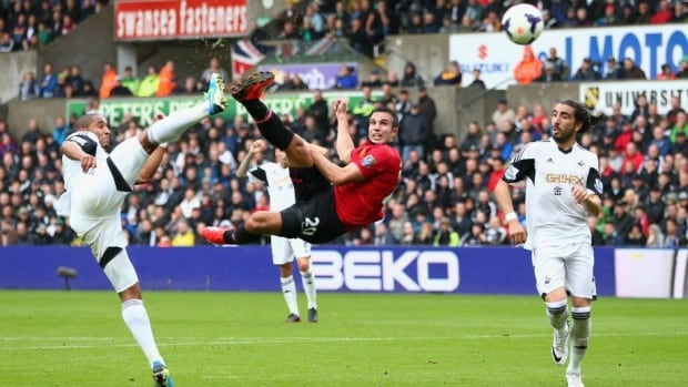 Robin van Persie of Manchester United, centre, scores against Swansea City at the Liberty Stadium on August 17, 2013 in Swansea, Wales.