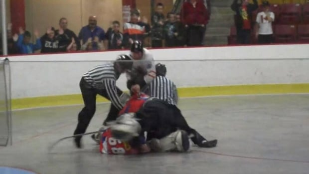 Justin Pender, top, wrestles with officials and Czech players in St. John's on Saturday.